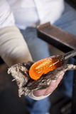 Glass blower shaping molten glass Royalty Free Stock Image