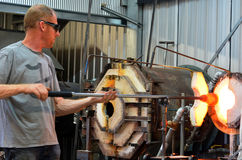 Glass blower shaping molten glass Royalty Free Stock Photos