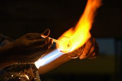 Glass blower using torch. Closeup of glass blower using a glassblowing torch stock photos