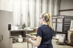 Glass blower. Woman heating glass in furnace in traditional glass making studio stock photos