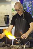 Glass blower at work Royalty Free Stock Images