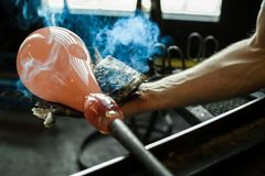 Glass-blower working with glass royalty free stock photography