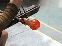 Glass Blowing. Glass being made by hand using the ancient art of glass blowing Royalty Free Stock Photography