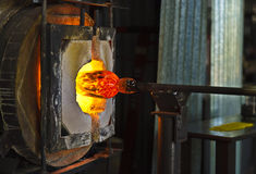 Glass Blowing Furnace. A demonstration of traditional glass blowing process in Asheville, North Carolina Stock Image