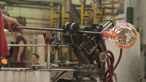 Glass-blowing maker at work stock video