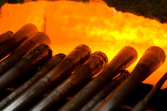 Glass blowing pipes in a furnace. This a traditional Swedish glass blowing factory in Kosta. The pipes are warmed up to be ready for glass blowing Royalty Free Stock Image