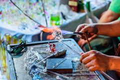 Glass blowing process . Royalty Free Stock Images