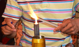 Glass blowing. A skilful artist shapes glass rods using heat from a flame. Picture taken May 2014 Royalty Free Stock Photography