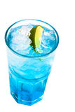 Glass of blue cocktail with lime on white Stock Image