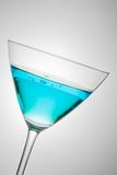 Glass with blue cocktail tilted Stock Photos