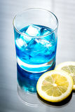Glass of blue curacao cocktail Royalty Free Stock Photos