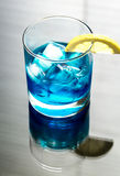 Glass of blue curacao cocktail Royalty Free Stock Photo
