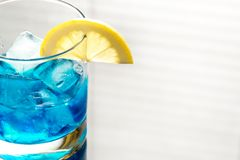 Glass of blue curacao cocktail Stock Image