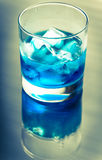 Glass of blue curacao cocktail Stock Photos