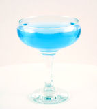 Glass with a blue drink. Selected on a white background Royalty Free Stock Images