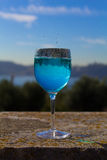 Glass with blue drink with water drops Royalty Free Stock Image
