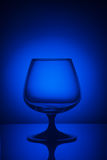 Glass in blue light. Empty glass in blue light Royalty Free Stock Photo