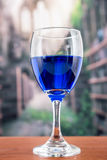 Glass with blue liquor Royalty Free Stock Photography