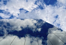 Glass blue sky. Nice blue cloudy sky reflected in a modern glass building in melbourne Stock Image