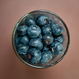 Glass of blueberries from above Royalty Free Stock Photography