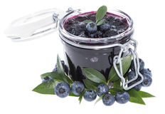 Glass with Blueberry Jam on white Royalty Free Stock Images