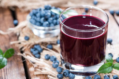 Glass with Blueberry Juice Royalty Free Stock Image