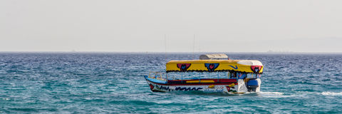 Glass boats in Aqaba Jordan. Glass boats sailing at the coast of Aqaba in Jordan stock images