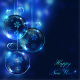 Glass bollar för jul på den oskarpa bakgrunden med ljus Royaltyfri Bild
