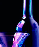 Glass and bottle. Glass and wine bottle with a black background Stock Photo