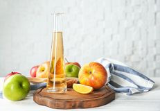 Glass bottle with apple vinegar royalty free stock photos