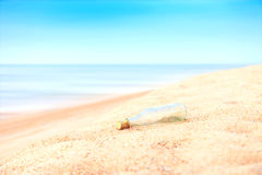 Glass bottle on the beach Stock Image
