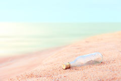 Glass bottle on the beach Stock Photography