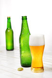 Glass and bottle of beer Stock Photography