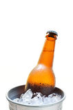 Glass bottle of beer in metal bucket isolated Royalty Free Stock Photo