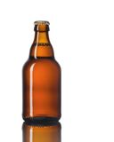 Glass bottle of beer on a white background. Stock Photos
