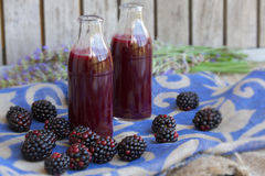Glass bottle of blackberries juice. Closeup Royalty Free Stock Image