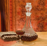 Glass and bottle of brandy Stock Photography