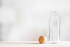 Glass bottle with a brown cork Royalty Free Stock Photos