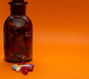 Glass bottle with capsules and sopy space Stock Images