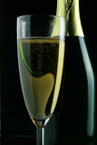 Glass and bottle of champagne Stock Image