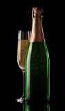 Glass and bottle of champagne Stock Photography