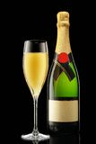 Glass and bottle of champagne Royalty Free Stock Images