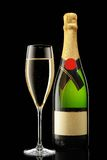 Glass and bottle of champagne Royalty Free Stock Photography
