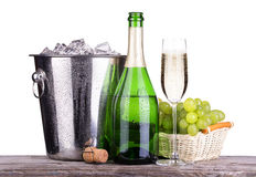 Glass and bottle of champagne in ice bucket Royalty Free Stock Image