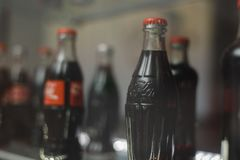 Samara Russia- 04.30.2019: glass bottle of coca cola behind the showcase. Coca Cola Museum royalty free stock photography