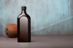 Glass bottle and coco Stock Image