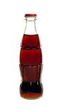 Glass bottle of cola soda isolated on a white Stock Images