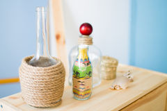 Glass bottle with colored sand Stock Image