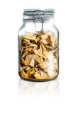 Glass bottle with dried fruit Stock Images