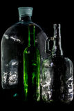 Glass bottle, empty, original, on black background Stock Images